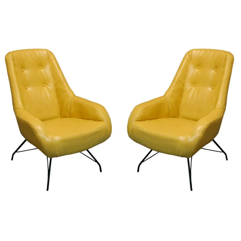 Pair of tan leather lounge chairs by Martin Eisler For Sale