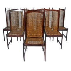 Set of 8 Solid Rosewood caned dining chairs by Celina