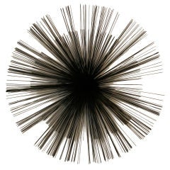 Starburst wall sculpture by Curtis Jere