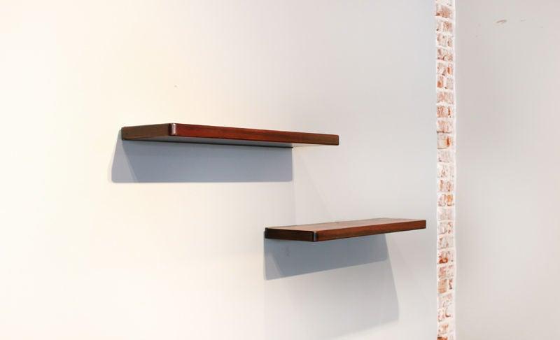 pair of wall hanging rosewood shelves by joaquim tenreiro