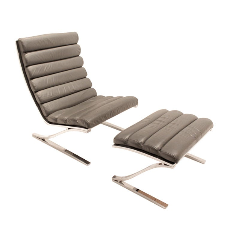 Tufted gray leather and chromed chair by design institute for Tufted leather chair design