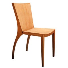 Single laminate wood chair with sculptural legs