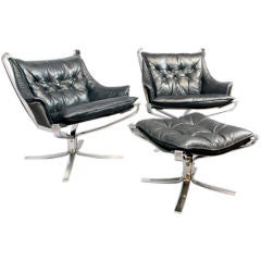 Pair of Falcon chairs and ottoman by Sigurd Russell
