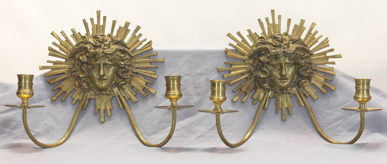 An elegant pair of French Neoclassical style gilt bronze wall sconces dating from the last half of the 19th century.
