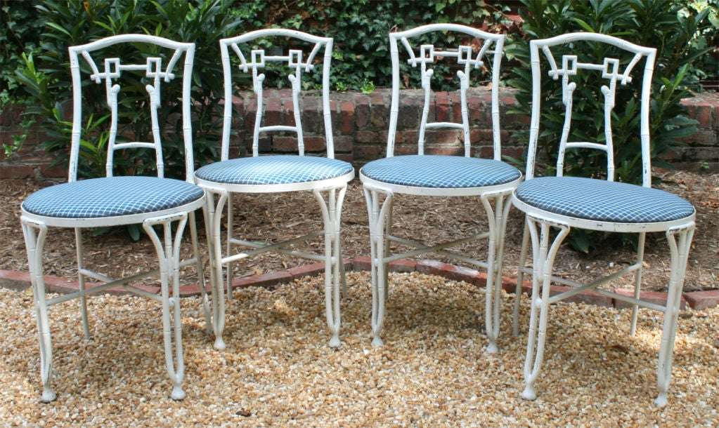 A charming set of four Hollywood Regency faux bamboo garden chairs. Suitable for use inside or out.