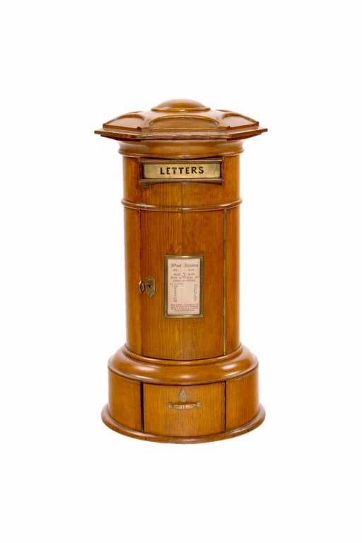 An original   mid 19th Century English Victorian Country House oak and gilt metal letter box of cylindrical box form with a domed top carved with a central boss within a cusped border.  The brass letter slot is inscribed