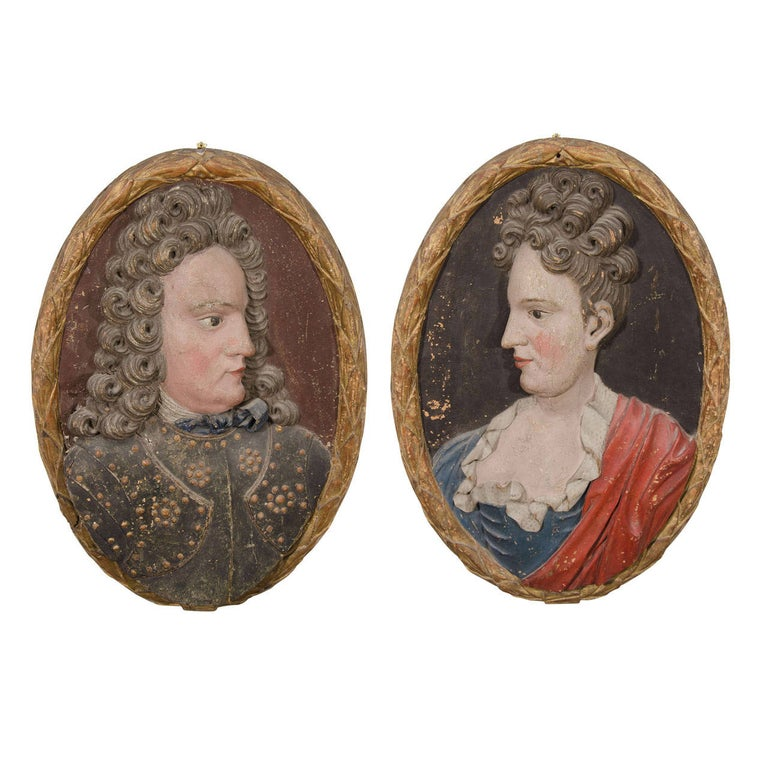 Set of 18th Century Carved Wood Plaques of a Man and Woman For Sale
