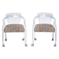 A Mid Century Pair of Lucite Armchairs on Casters