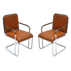 Pair of Mid Century Chrome and Vinyl Armchairs