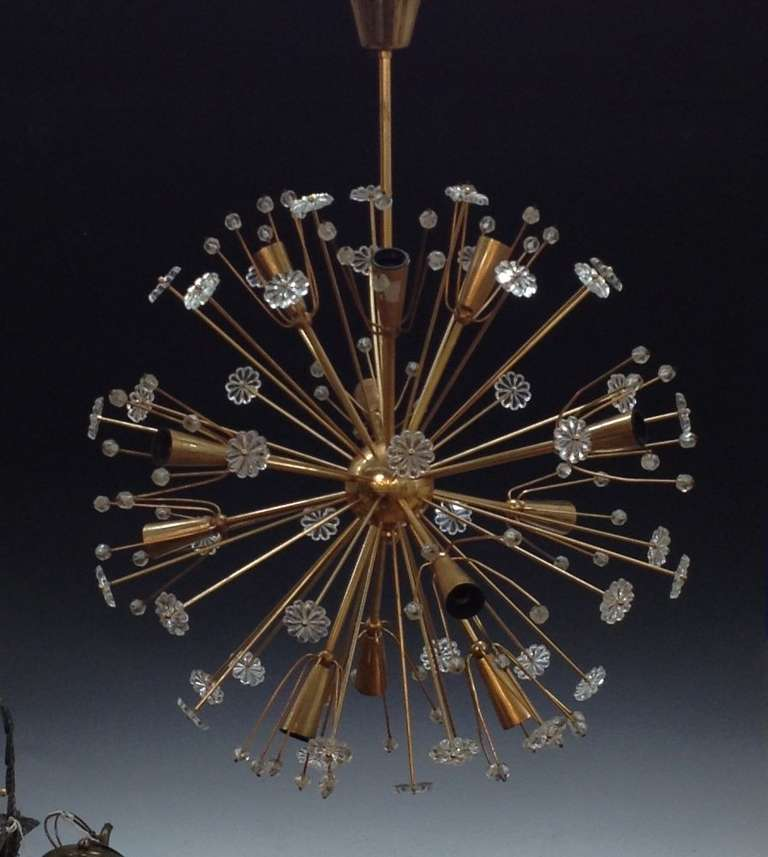 "A vintage glass and brass ""Starburst"" pendant by noted designer Emil Stejnar. Good vintage condition with age appropriate wear. Ready to hang with E12 European to E 14 American candelabra socket adapters."