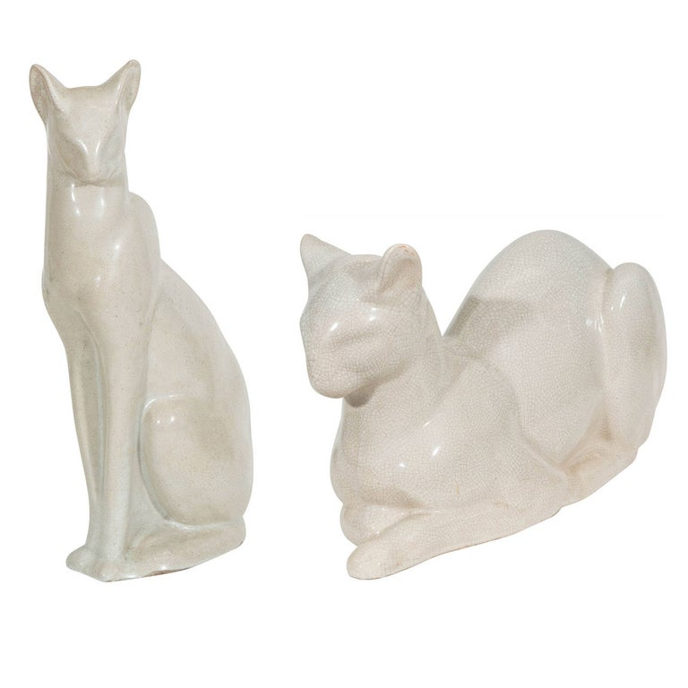 French Art Deco Siamese cat sculpture, in an upright position in white ceramic with 'craquelure' (crackle) glaze. Good vintage condition, consistent with age and prior use.