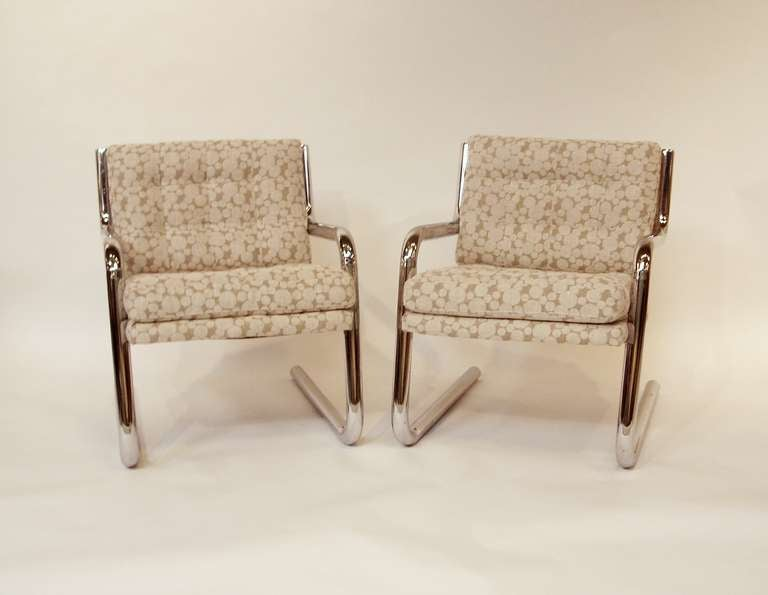 A vintage pair of chrome chairs with tubular frames newly reupholstered in beige and cream polka dot linen.  Reduced from: $3900
