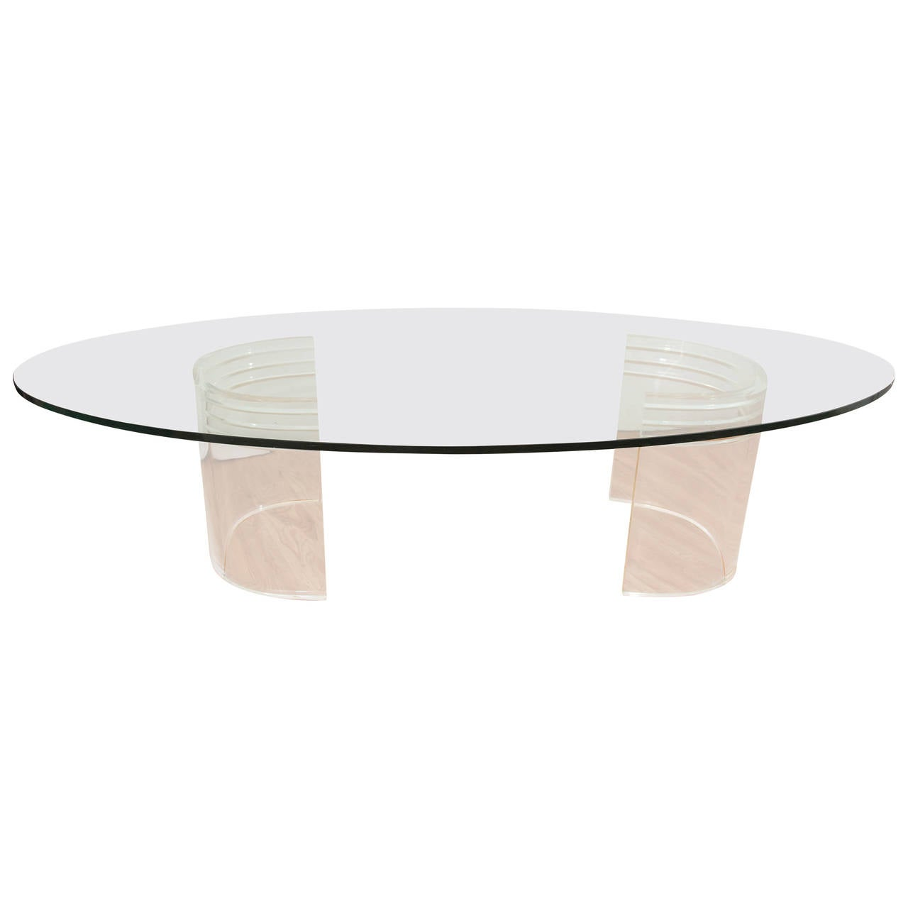 Midcentury coffee table with glass oval top on two 39 c 39 form lucite bases for sale at 1stdibs Glass oval coffee tables