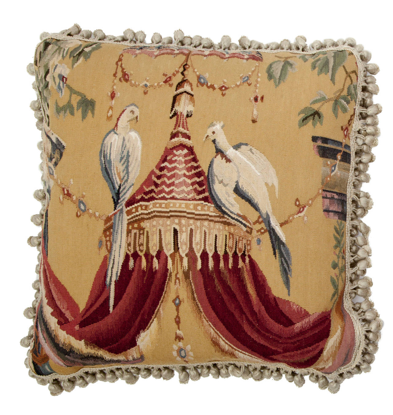Two pictorial pillows made from fragments of the same Aubusson tapestry. One with doves perched atop an elaborate, draped baldaquin and the other Court Jester dancing to the music of an elaborately costumed violinist. Velvet backed with silk ball