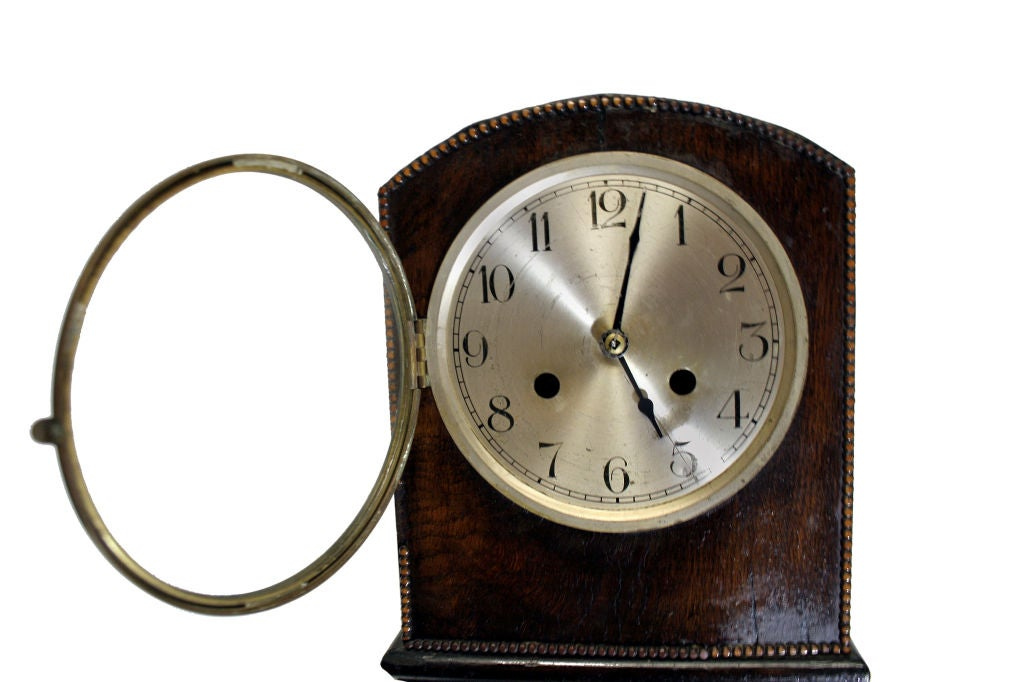 Encased in oak with a wonderful diamond front, this wonderful clock features Arabic numerals on a silver plate face. Two openings on the face allow one to have the chime and the clock function separately; that is, the clock can be silenced if one so