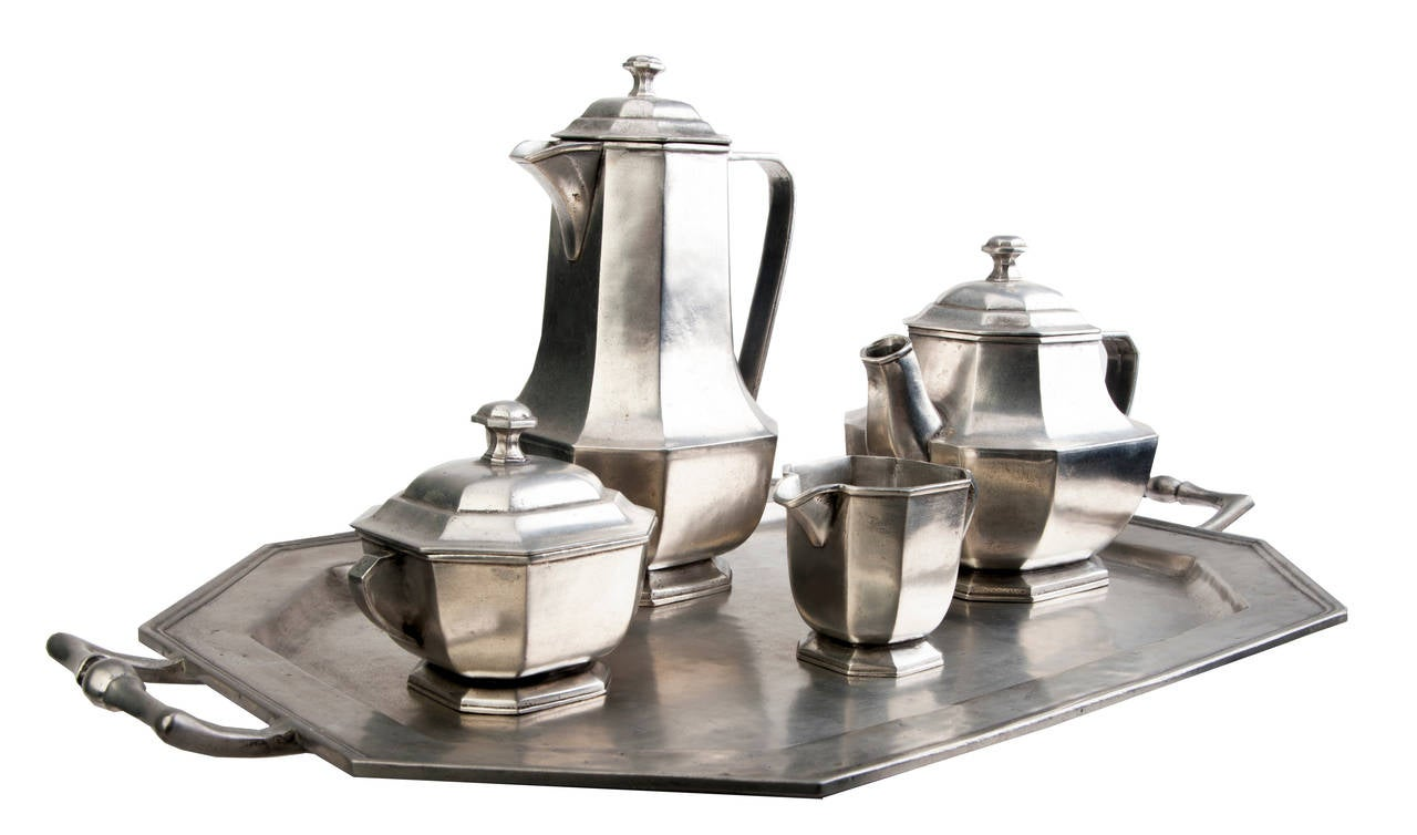 Exquisite Italian five-piece pewter tea set. Coffee and tea pots, cream and sugar. Tray with nice handles.