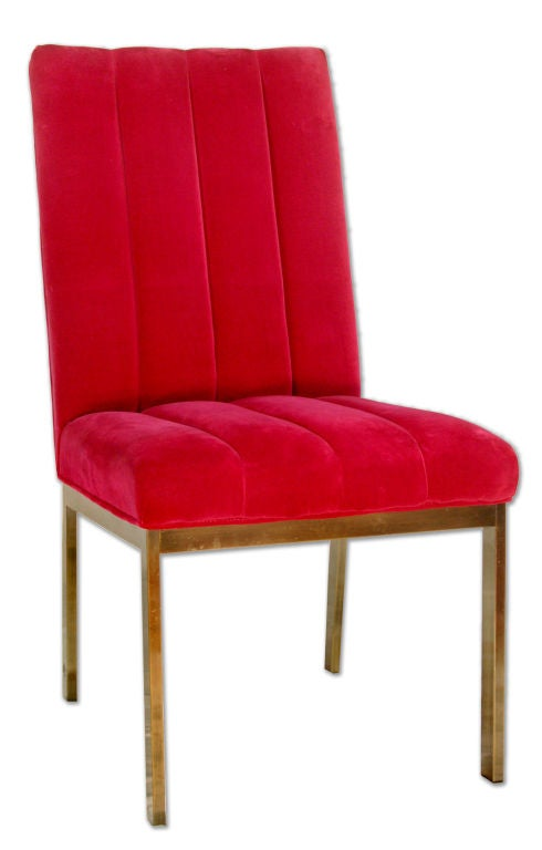 This pair of midcentury Parsons chairs sit upon chrome bases. They are covered in channeled vivid raspberry velvet upholstery with piping. The artfully executed upholstery gives these chairs both the sharp clean lines of midcentury design and the