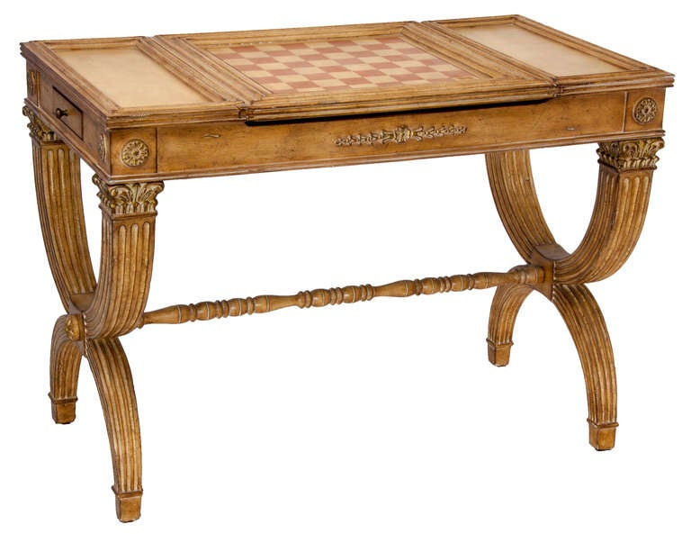 Neo-classical style gaming table with reversible top will afford a game of checkers, chess, or not. With private drawers for each partner and side drawers and side stations for cocktails, its the perfect size for setting an amusement corner. Tres