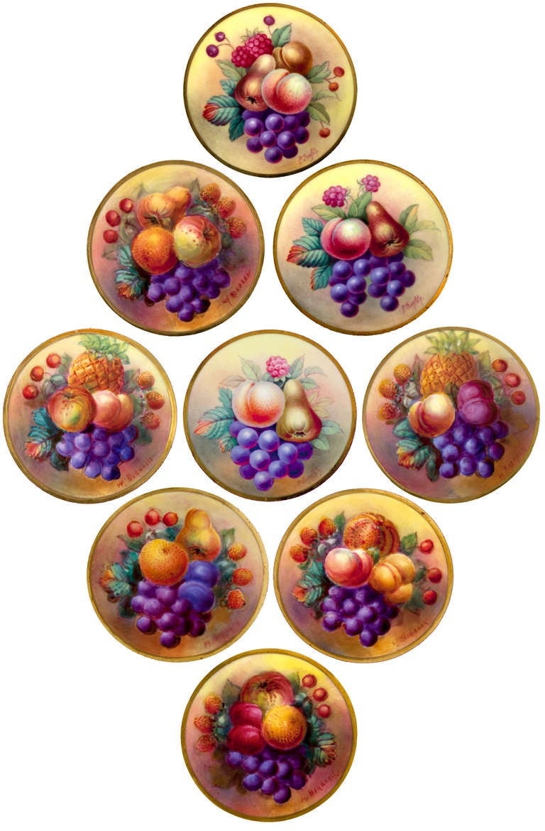 With a rich magenta background this hand signed collection of Crescent/George Jones & Sons dessert plates, features a brightly hand painted variety of summer fruits centered with gilt bordered surround and elaborately scalloped rims. English, 20th C.
