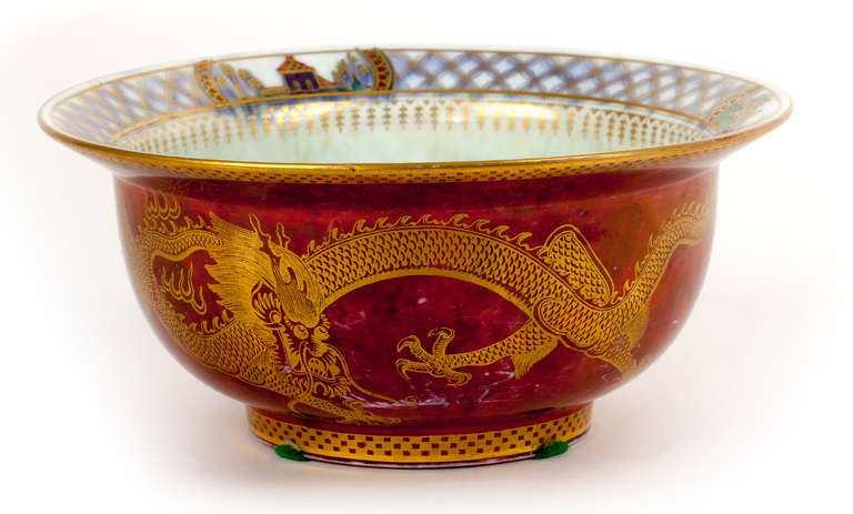 This gorgeous Wedgewood piece with a mother of pearl interior is enveloped by a powerful golden dragon set against a mottled red exterior. A signature piece, this classic English Wedgewood would make an enchanting addition to anyones collection.