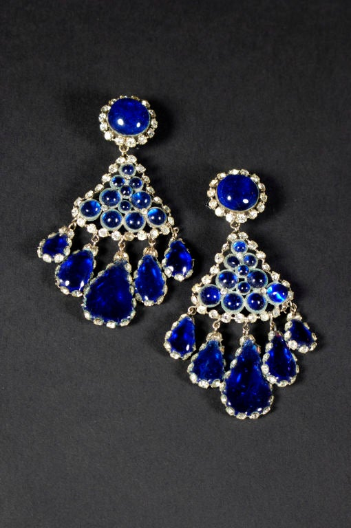 Elegant clip style chandelier earrings with cascading hand made blue cabochon glass surrounded by clear cut rhinestones. These earrings are stamped