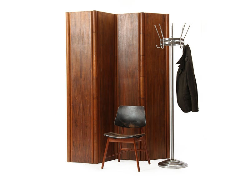 A walnut four-panel folding screen with integral cylinder hinges. Panel is 19.5