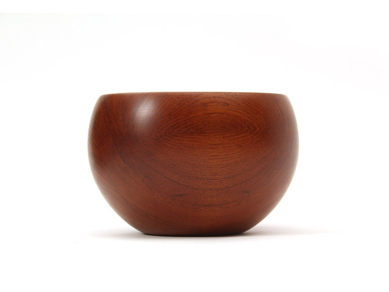 A large hand turned salad bowl with 12 matching bowls. A serving set completes this listing.