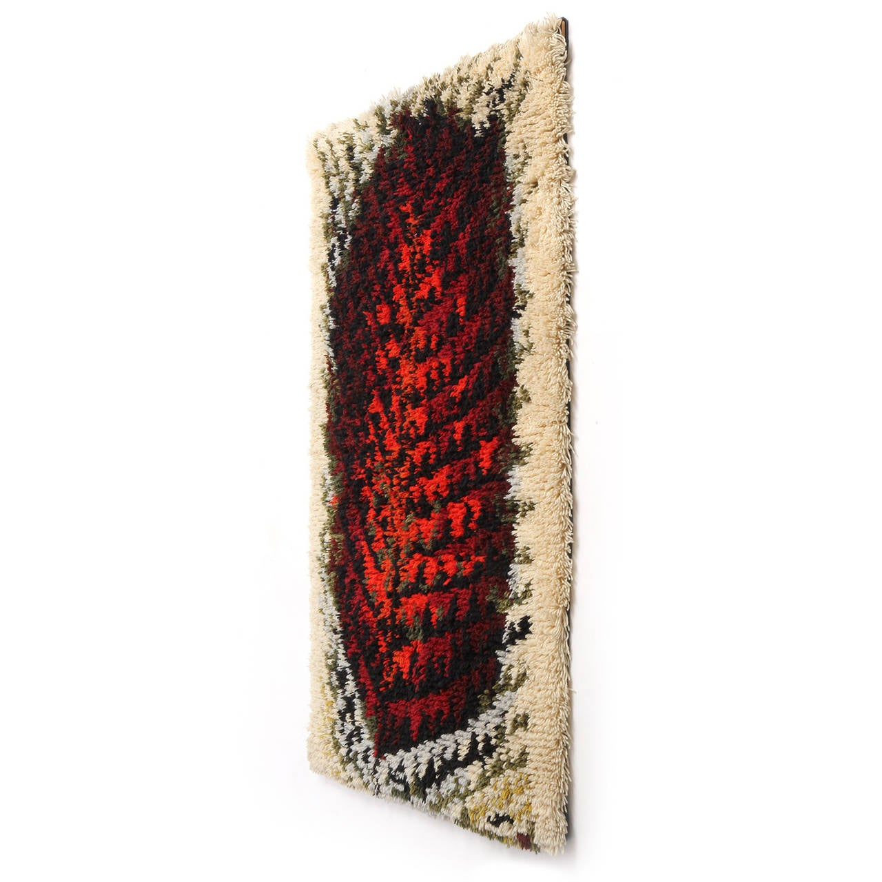 A fine handmade Rya rug or wall hanging having an expressive abstracted shape, masterfully loomed with a thick pile in a rich palette of cream, grey, russet, black, red, blue and burnt umber.