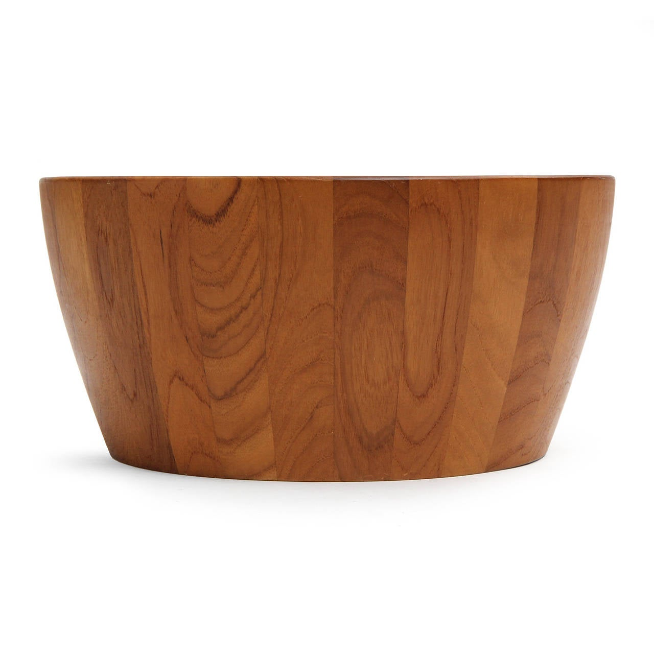 A Scandinavian Modern large scaled and beautifully crafted staved teak bowl having a subtly flaring round form. Designed and manufactured by Richard Nissen in Denmark, circa 1960s.