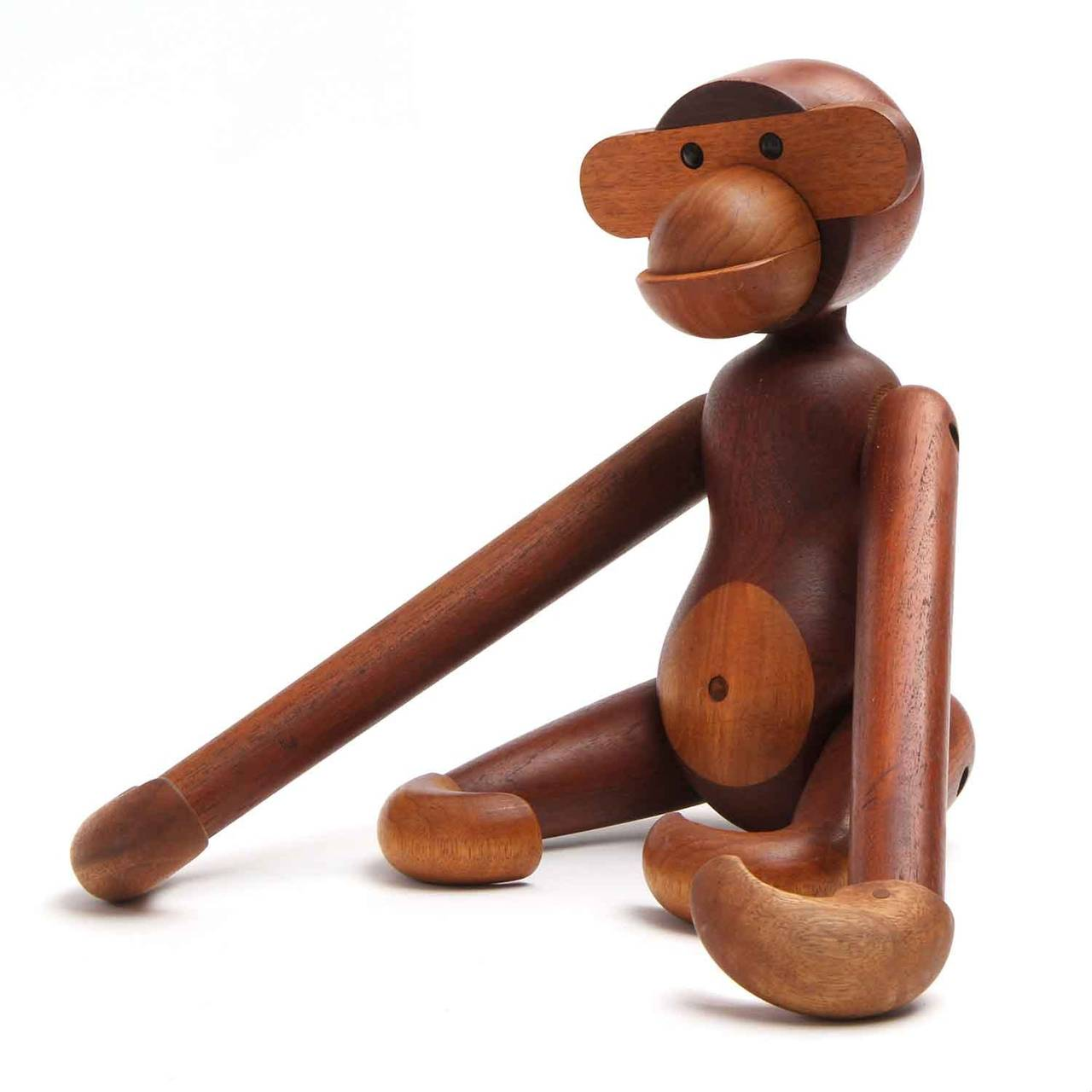 A delightfully expressive and beautifully crafted monkey made of teak and limba. This uncommon example is the largest size that was produced for the public.