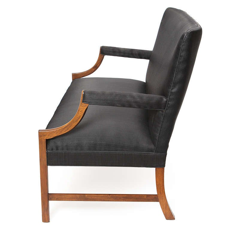 A stately and elegant modern Chippendale-influenced settee finely crafted in mahogany with original horsehair upholstery and leather welting.