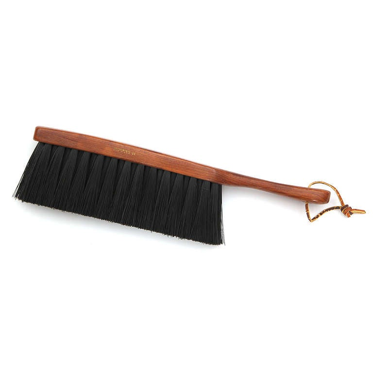 A beautifully crafted garment brush made of warmly-toned walnut and soft horsehair.