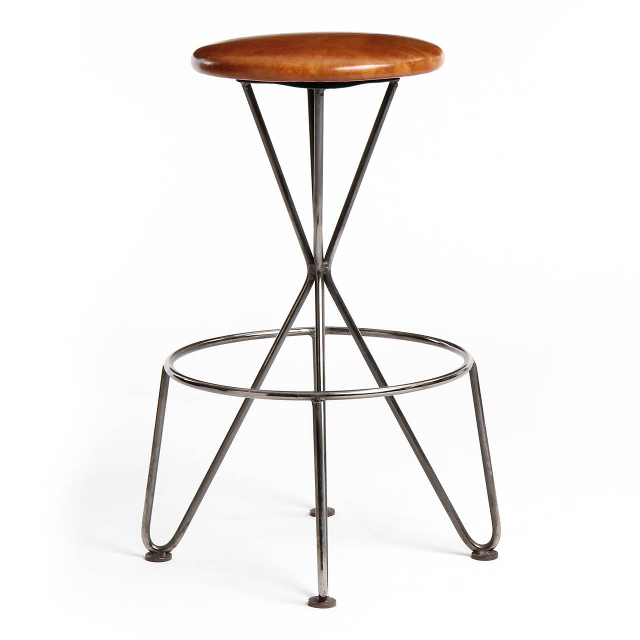 A stool having a sinuous steel base with a floating round foot rail supporting a swiveling leather upholstered seat.