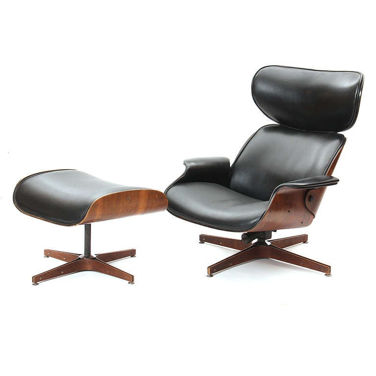 A swivelling lounge chair and ottoman for Plycraft having molded walnut shells and bases form fitted with seamless upholstery that is devoid of tufting.