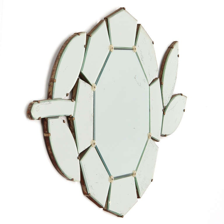 A finely crafted Mid-Century Modern mirror comprised of multiple shaped elements in the form of a flower. Made in the USA, circa 1950s.