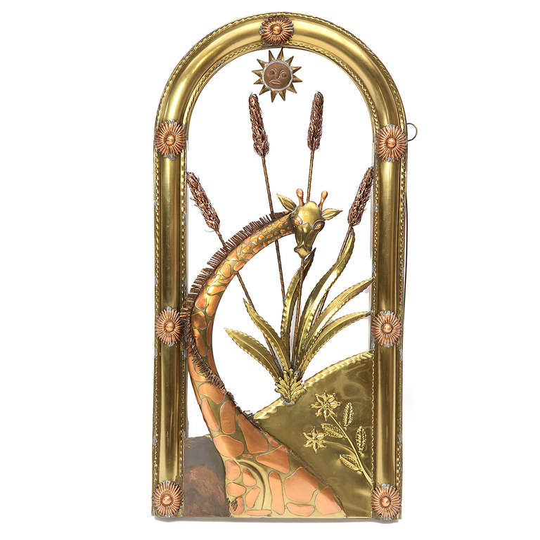 A unique tree-of life triptych sculpture beautifully rendered in repoussé and hand-formed copper and brass featuring an expressive and delightful array of flora and fauna.