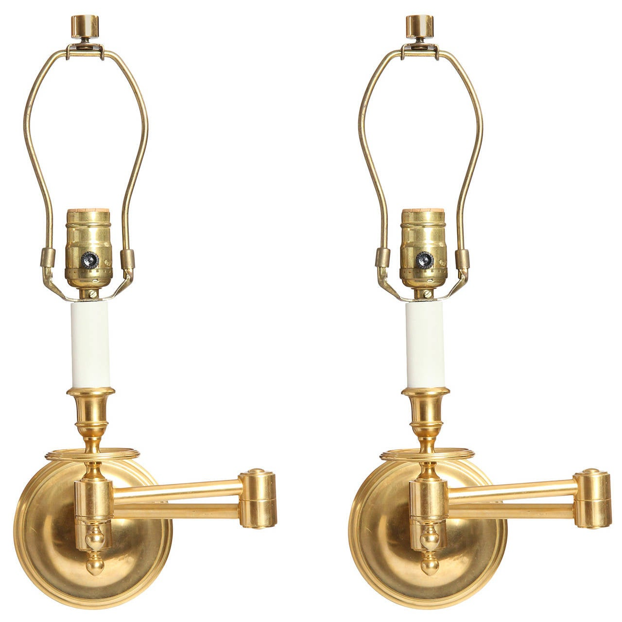 A Pair of Brass Swing Arm Wall Sconces For Sale at 1stdibs