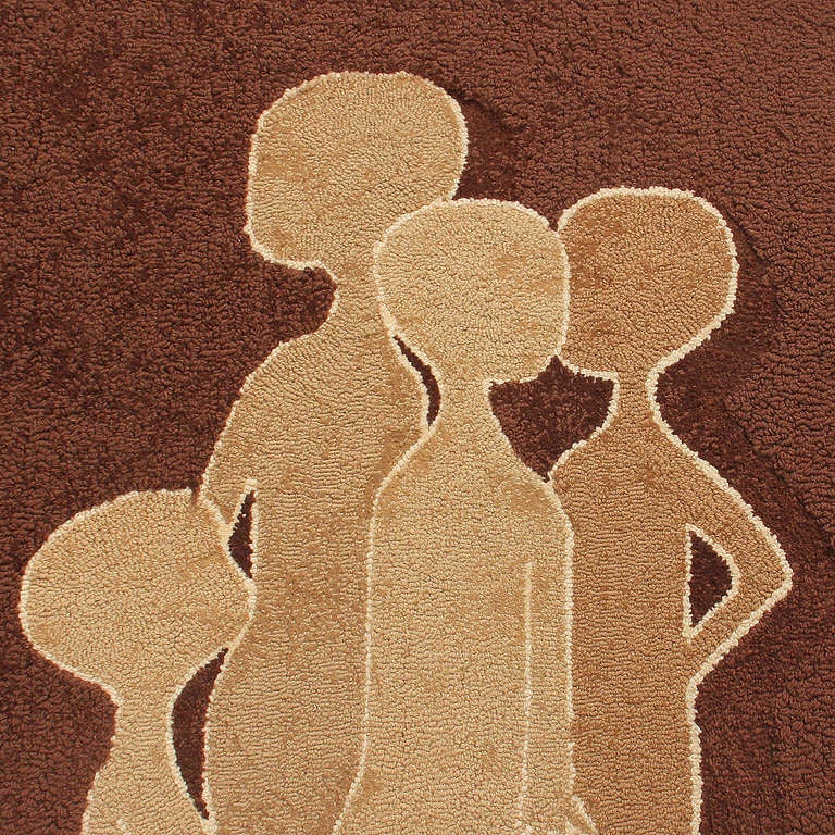 A unique looped wool tapestry in earth tones depicting seven (7) abstract figures in two groups. Signed by the artist.