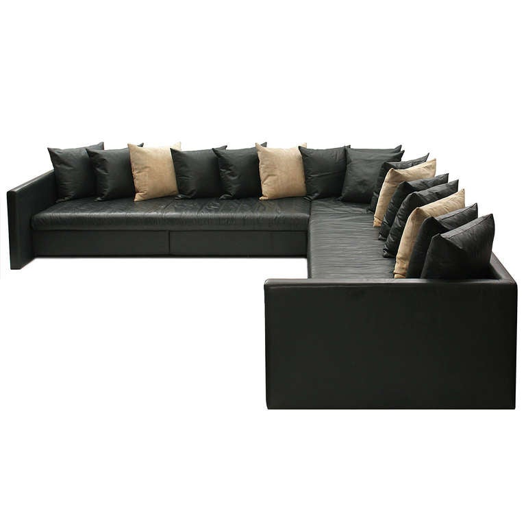 A Beautifully Minimalist Rectilinear Sectional Sofa With The Original Hunter  Green Leather Upholstery And Sixteen Pillows