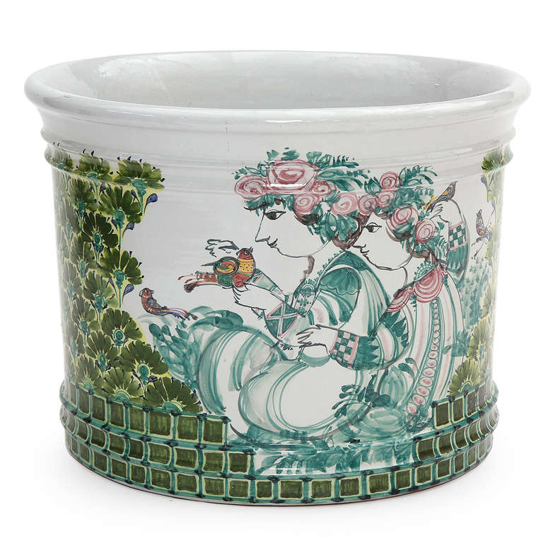 A large-scaled and unique studio-made signed ceramic jardinière depicting a pair of beautifully painted figures in a lush, vividly polychromed garden.