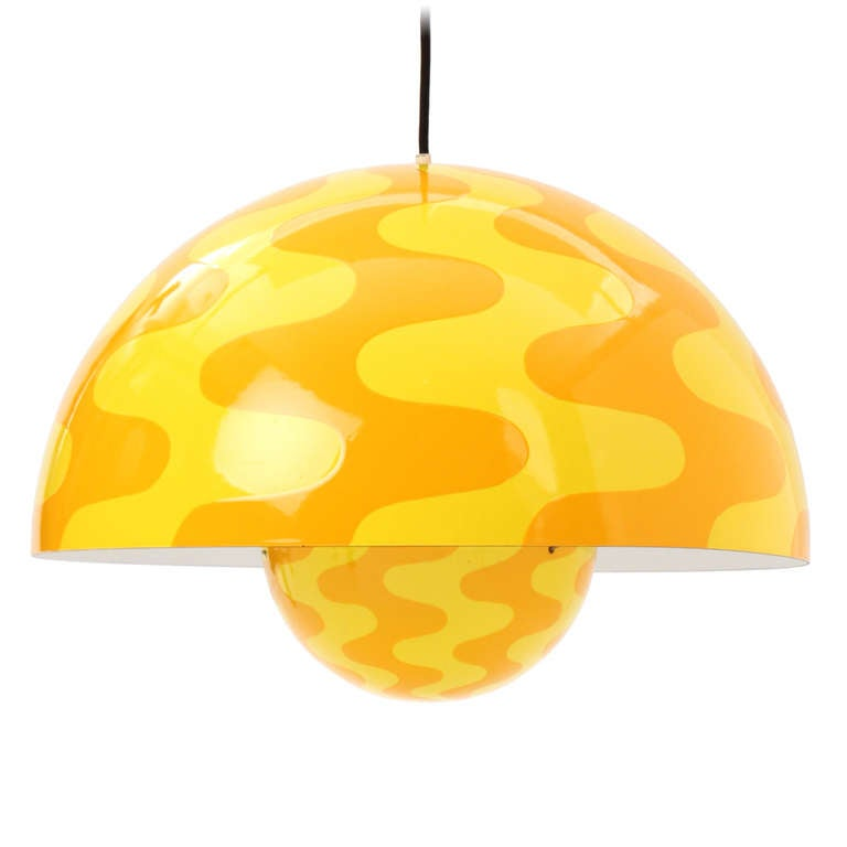 This rare pendant is the largest size that was manufactured and has undulating waves in yellow and orange executed in porcelain-enameled steel.
