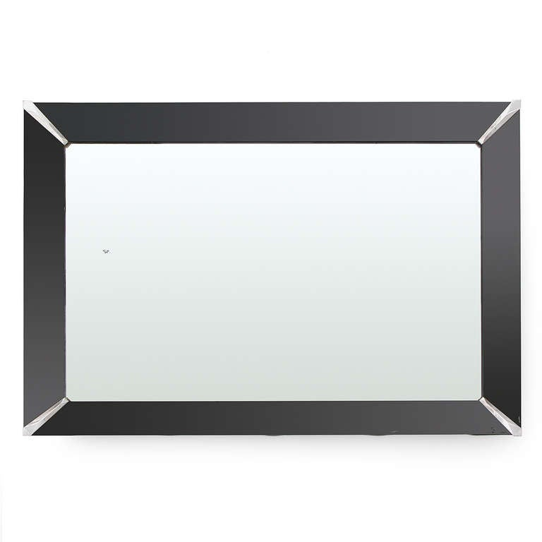 A simple wall mirror with an angled black frame.