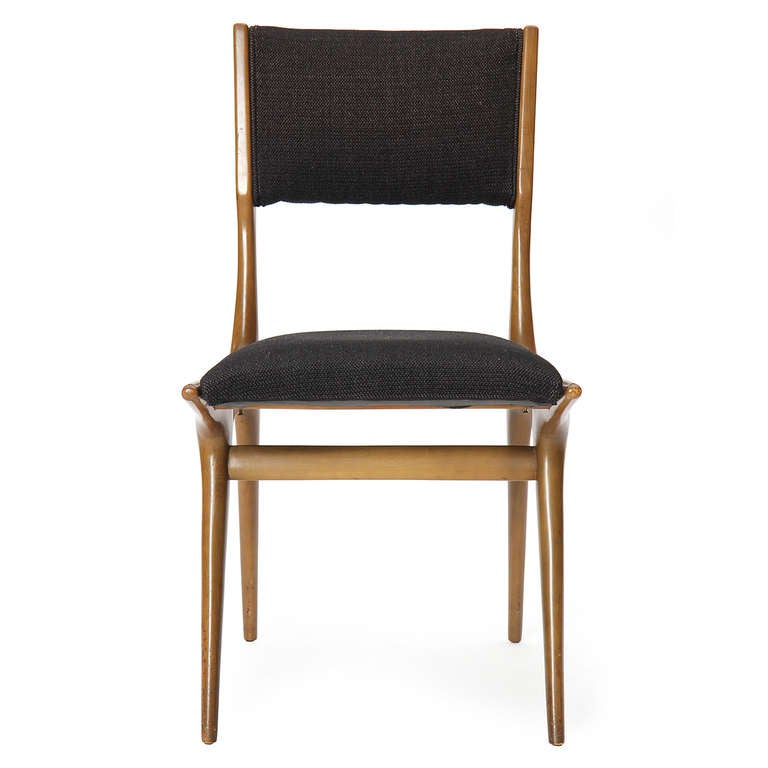 An excellent set of four (4) armless Mid-Century Modern dining chairs designed by Carlo di Carli in walnut wood with an upholstered seat and back. Made by M. Singer & Sons in the USA, circa 1950s.