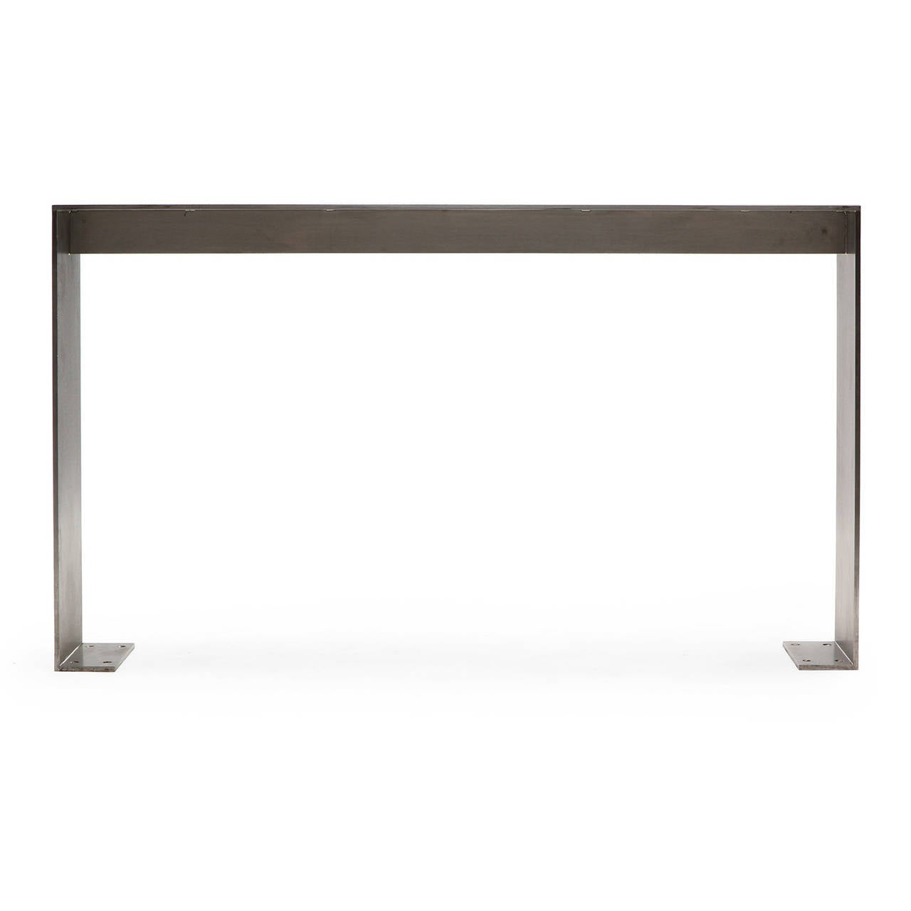 A masterfully fabricated and generously scaled rectilinear polished steel console table from New York's Yankee Stadium having inlaid Yankees logos on the top.
