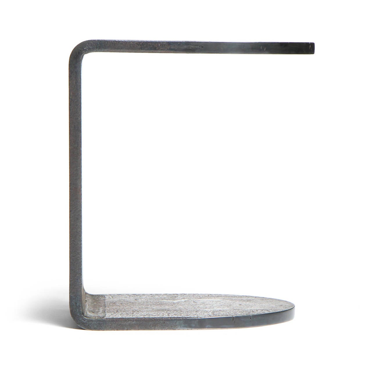 A superbly spare and substantial side table, impeccably handcrafted from beautifully patinated natural steel.