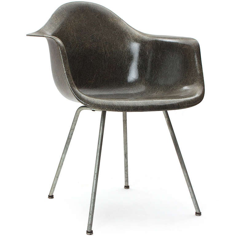 """A rope edge fiberglass """"Zenith"""" shell chair with a brushed stee X base, in elephant grey."""