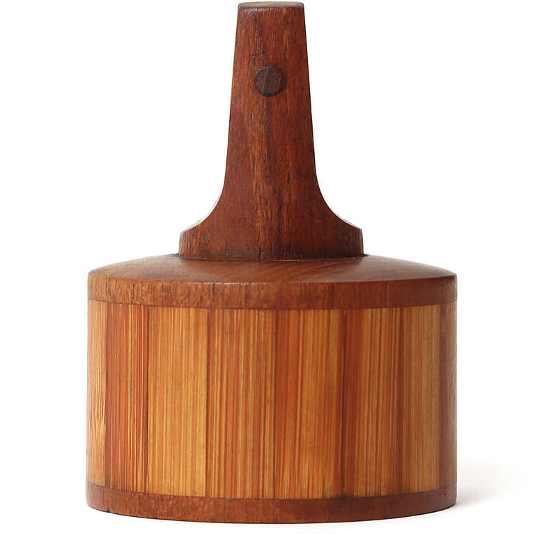 A very rare pepper mill by Jens Quistgaard executed in rich teak and split bamboo. Produced by Dansk in Denmark, circa 1960s.