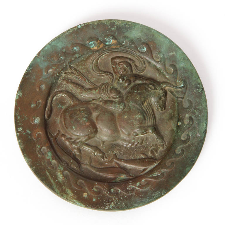 A warmly patinated Art Deco bronze plaque depicting the flight of Europa, signed and dated by the Paul Manship. Made in the USA, circa 1946.