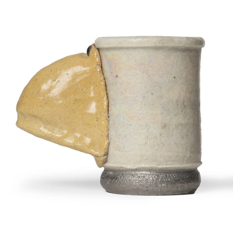 A wonderful example of California Funk pottery: a hand thrown salt-glazed cup utilizing an expressive nose as a handle. Signed and dated BC 70.
