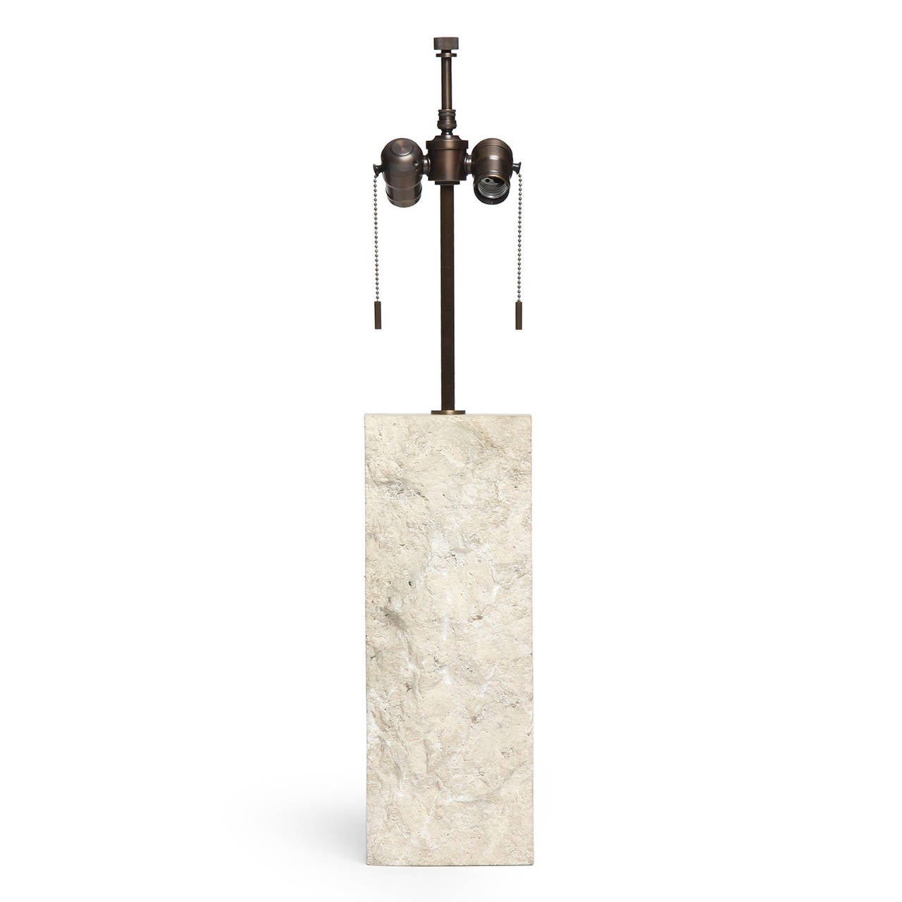 A substantial rectangular solid white limestone table lamp with a chipped surface.